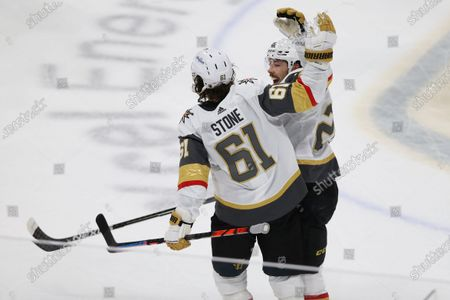 Stock Photo of Vegas Golden Knights' Mark Stone (61) celebrate with teammate Chandler Stephenson (20) after scoring a goal against the Minnesota Wild during the third period in Game 3 of a first-round NHL hockey playoff series, in St. Paul, Minn. Vegas won 5-2