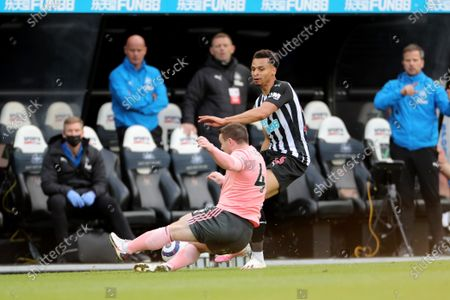 John Fleck of Sheffield United tackles Newcastle United's Jacob Murphy during the Premier League match between Newcastle United and Sheffield United at St. James's Park, Newcastle on Wednesday 19th May 2021.