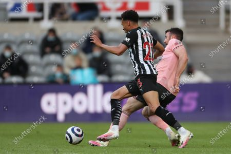 Jacob Murphy of Newcastle United in action with Sheffield United's John Fleck during the Premier League match between Newcastle United and Sheffield United at St. James's Park, Newcastle on Wednesday 19th May 2021.