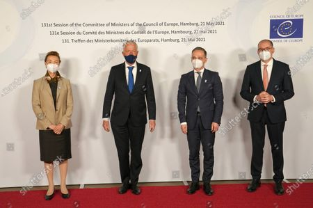 German Minister for Foreign Affairs Heiko Maas (2-R), Marija Pejcinovic Buric (L), Secretary General of the Council of Europe, Robert Ragnar Spano (2-L), President of the European Court of Human Rights, and Nils Annen, Minister of State at the Federal Foreign Office, pose prior to the 131st meeting of the Committee of Ministers of the Council of Europe at City Hall in Hamburg, Germany, 21 May 2021. At the meeting, the six-month chairmanship of the Committee of Ministers of the Council of Europe will be handed over from Germany to Hungary. The Council of Europe, with its seat in Strasbourg, France, works together with its Court of Justice to uphold human rights in EU member states.