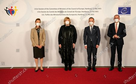 Stock Photo of German Minister for Foreign Affairs Heiko Maas (2-R), Marija Pejcinovic Buric (L), Dunja Mijatovic, Commissioner for Human Rights of the Council of Europe (2-L), and Nils Annen, Minister of State at the Federal Foreign Office, pose prior to the 131st meeting of the Committee of Ministers of the Council of Europe at City Hall in Hamburg, Germany, 21 May 2021. At the meeting, the six-month chairmanship of the Committee of Ministers of the Council of Europe will be handed over from Germany to Hungary. The Council of Europe, with its seat in Strasbourg, France, works together with its Court of Justice to uphold human rights in EU member states.