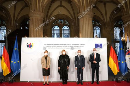 German Minister for Foreign Affairs Heiko Maas (2-R), Marija Pejcinovic Buric (L), Dunja Mijatovic, Commissioner for Human Rights of the Council of Europe (2-L), and Nils Annen, Minister of State at the Federal Foreign Office, pose prior to the 131st meeting of the Committee of Ministers of the Council of Europe at City Hall in Hamburg, Germany, 21 May 2021. At the meeting, the six-month chairmanship of the Committee of Ministers of the Council of Europe will be handed over from Germany to Hungary. The Council of Europe, with its seat in Strasbourg, France, works together with its Court of Justice to uphold human rights in EU member states.
