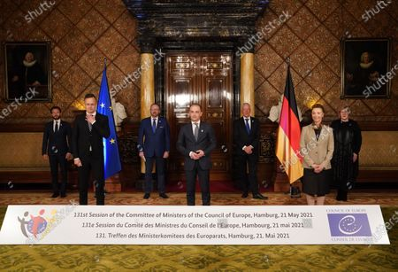 German Foreign Minister Heiko Maas (C) stands with (L-R) Robert Ragnar Spano, President of the European Court of Human Rights, Peter Szijjarto, Foreign Minister of Hungary, Rik Daems, President of the Parliamentary Assembly of the Council of Europe, Leendert Verbeek, President of the Congress of Local and Regional Authorities of the Council of Europe, Marija Pejcinovic Buric, Secretary General of the Council of Europe, and Dunja Mijatovic, Commissioner for Human Rights of the Council of Europe, during the family photo at the meeting of the 131st Committee of Ministers of the Council of Europe in the City Hall   in Hamburg, Germany, 21 May 2021. At the meeting, the six-month chairmanship of the Committee of Ministers of the Council of Europe will be handed over from Germany to Hungary. The Council of Europe, with its seat in Strasbourg, France, works together with its Court of Justice to uphold human rights in EU member states.