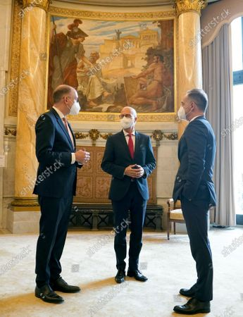 Heiko Maas (R), German Minister for Foreign Affairs, Peter Tschentscher, First Mayor of the Free and Hanseatic City of Hamburg, and Niels Annen (L), Minister of State at the Federal Foreign Office, wait at the beginning of the 131st meeting of the Committee of Ministers of the Council of Europe in the Kaisersaal at City Hall in Hamburg, Germany, 21 May 2021. At the meeting, the six-month chairmanship of the Committee of Ministers of the Council of Europe will be handed over from Germany to Hungary. The Council of Europe, with its seat in Strasbourg, France, works together with its Court of Justice to uphold human rights in EU member states.