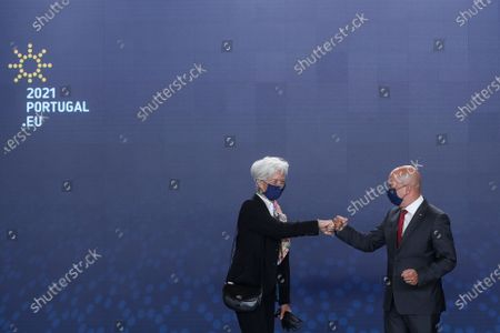 Stock Picture of Portuguese State Minister for Finance Joao Leao (R) welcomes President of the European Central Bank (ECB) Christine Lagarde (L) as she arrives to attend a Eurogroup meeting under the Portuguese Presidency of the Council in Lisbon, Portugal, 21 May 2021. Finance Ministers will discuss macroeconomic and fiscal developments in the euro area and analyze the functioning of adjustment mechanisms, adoption of the Eurogroup work program for the second half of 2021 and listen to the reports of the presidents of the Supervisory Board of the European Central Bank (ECB) and the Single Resolution Board. MARIO CRUZ/POOL/LUSA
