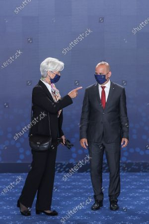 Portuguese State Minister for Finance Joao Leao (R) welcomes President of the European Central Bank (ECB) Christine Lagarde (L) as she arrives to attend a Eurogroup meeting under the Portuguese Presidency of the Council in Lisbon, Portugal, 21 May 2021. Finance Ministers will discuss macroeconomic and fiscal developments in the euro area and analyze the functioning of adjustment mechanisms, adoption of the Eurogroup work program for the second half of 2021 and listen to the reports of the presidents of the Supervisory Board of the European Central Bank (ECB) and the Single Resolution Board. MARIO CRUZ/POOL/LUSA