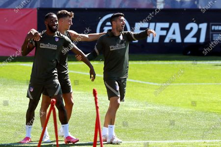 Atletico Madrid players (L-R) Moussa Dembele, Marcos Llorente, and Luis Suarez attend their team's training session at Sports City in Majadahonda, near Madrid, Spain, 21 May 2021. Atletico Madrid will face Real Valladolid in their Spanish La Liga soccer match on 22 May 2021.