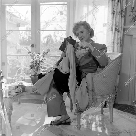 Billie Burke preparing her clothes for donation to United Nations Relief and Rehabilitation Administration, Los Angeles, California, 1945.