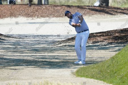 Marc Leishman, of Australia, hits out of he rough on the first hole during the second round of the PGA Championship golf tournament on the Ocean Course, in Kiawah Island, S.C