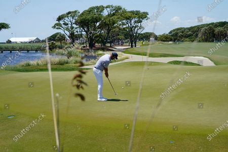 Marc Leishman, of Australia, putts on the first hole during the second round of the PGA Championship golf tournament on the Ocean Course, in Kiawah Island, S.C