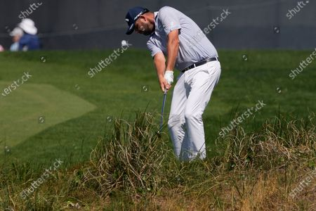 Marc Leishman, of Australia, chips to the green on the 10th hole during the second round of the PGA Championship golf tournament on the Ocean Course, in Kiawah Island, S.C