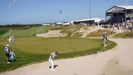 Marc Leishman, of Australia, hits out of the bunker on the tenth hole during the second round of the PGA Championship golf tournament on the Ocean Course, in Kiawah Island, S.C