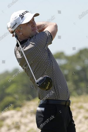 Martin Laird, of Scotland, watches a tee shot on the 15th hole during the second round of the PGA Championship golf tournament on the Ocean Course, in Kiawah Island, S.C