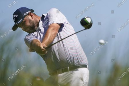 Marc Leishman, of Australia, hits his tee shot on the ninth hole during the second round of the PGA Championship golf tournament on the Ocean Course, in Kiawah Island, S.C