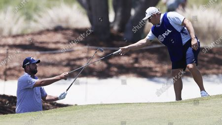 Marc Leishman of Australia swaps clubs with his caddie on the first hole during the second round of the 2021 PGA Championship golf tournament on the Ocean Course at Kiawah Island, South Carolina, USA, 21 May 2021. The PGA Championship runs from 20 May through 23 May.