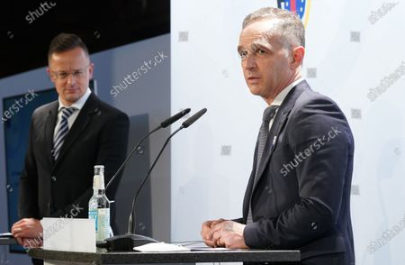 Hungarian Foreign Minister Peter Szijjarto (L) and German Minister for Foreign Affairs Heiko Maas give a press conference after the 131st meeting of the Committee of Ministers of the Council of Europe at City Hall in Hamburg, Germany, 21 May 2021. At the meeting, the six-month chairmanship of the Committee of Ministers of the Council of Europe will be handed over from Germany to Hungary. The Council of Europe, with its seat in Strasbourg, France, works together with its Court of Justice to uphold human rights in EU member states.