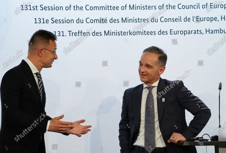 Hungarian Foreign Minister Peter Szijjarto (L) and German Minister for Foreign Affairs Heiko Maas talk following a press conference after the 131st meeting of the Committee of Ministers of the Council of Europe at City Hall in Hamburg, Germany, 21 May 2021. At the meeting, the six-month chairmanship of the Committee of Ministers of the Council of Europe will be handed over from Germany to Hungary. The Council of Europe, with its seat in Strasbourg, France, works together with its Court of Justice to uphold human rights in EU member states.