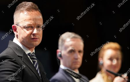 Stock Image of (L-R) Hungarian Foreign Minister Peter Szijjarto, German Minister for Foreign Affairs Heiko Maas and Secretary General of the Council of Europe Marija Pejcinovic Buric attend a press conference after the 131st meeting of the Committee of Ministers of the Council of Europe at City Hall in Hamburg, Germany, 21 May 2021. At the meeting, the six-month chairmanship of the Committee of Ministers of the Council of Europe will be handed over from Germany to Hungary. The Council of Europe, with its seat in Strasbourg, France, works together with its Court of Justice to uphold human rights in EU member states.