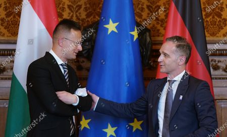 German Minister for Foreign Affairs Heiko Maas (R) and Hungarian Foreign Minister Peter Szijjarto at the 131st meeting of the Committee of Ministers of the Council of Europe at City Hall in Hamburg, Germany, 21 May 2021. At the meeting, the six-month chairmanship of the Committee of Ministers of the Council of Europe will be handed over from Germany to Hungary. The Council of Europe, with its seat in Strasbourg, France, works together with its Court of Justice to uphold human rights in EU member states.