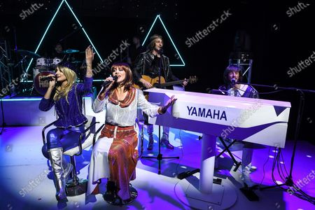 Stock Picture of Edward Handoll, who plays Bjsrn Ulvaeus, Rhiannon Porter who plays Agnetha FSltskog, JoJo Desmond who plays Anni-Frid Lyngstad and Loucas Hajiantoni who plays BennyAndersson and Musical Director on stage during a photocall for the musical Abba Mania, 47 years after Waterloo triumphed at the Eurovision Song Contest, the cast of ABBA MANIA return to the West End for the first time in nearly two decades at the Shaftesbury Theatre