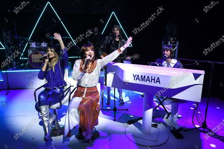 Stock Image of Edward Handoll, who plays Bjsrn Ulvaeus, Rhiannon Porter who plays Agnetha FSltskog, JoJo Desmond who plays Anni-Frid Lyngstad and Loucas Hajiantoni who plays BennyAndersson and Musical Director on stage during a photocall for the musical Abba Mania, 47 years after Waterloo triumphed at the Eurovision Song Contest, the cast of ABBA MANIA return to the West End for the first time in nearly two decades at the Shaftesbury Theatre