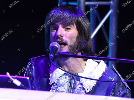 Stock Photo of Loucas Hajiantoni who plays Benny Andersson and Musical Director on stage during a photocall for the musical Abba Mania, 47 years after Waterloo triumphed at the Eurovision Song Contest, the cast of ABBA MANIA return to the West End for the first time in nearly two decades at the Shaftesbury Theatre