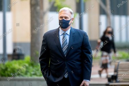 Stock Image of Apple fellow Phil Schiller enters the Ronald V. Dellums building in Oakland, Calif., to testify in a federal court case brought by Epic Games on . Epic, maker of the video game Fortnite, charges that Apple has transformed its App Store into an illegal monopoly