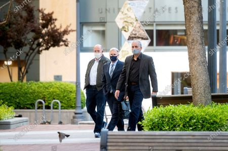 Apple fellow Phil Schiller, center, enters the Ronald V. Dellums building in Oakland, Calif., to testify in a federal court case brought by Epic Games on . Epic, maker of the video game Fortnite, charges that Apple has transformed its App Store into an illegal monopoly
