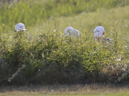 Tony Finau, Matt Fitzpatrick of England and Corey Conners of Canada walk to the 10th fairway in the second round of the 103rd PGA Championship at Kiawah Island Golf Resort Ocean Course on Kiawah Island, South Carolina on Friday, May 21, 2021.