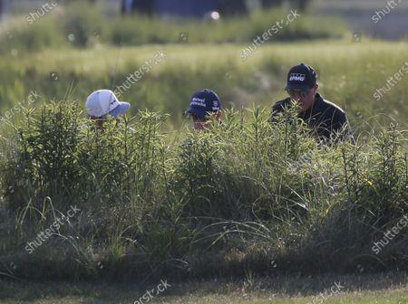 Jason Day of Australia, Padraig Harrington of Ireland and Phil Mickelson walk to the 10th fairway in the second round of the 103rd PGA Championship at Kiawah Island Golf Resort Ocean Course on Kiawah Island, South Carolina