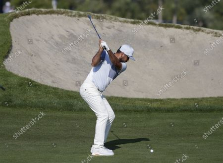 Jason Day of Australia hits his approach shot to the 13th green in the second round of the 103rd PGA Championship at Kiawah Island Golf Resort Ocean Course on Kiawah Island, South Carolina