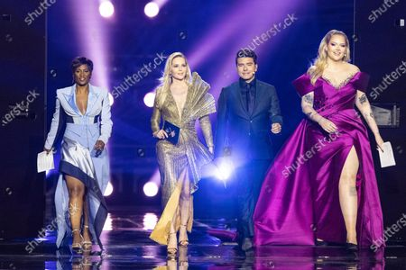 Stock Image of The hosts of the show (l-r) Edsilia Rombley, Chantal Janzen, Jan Smit and Nikkie de Jager during the flag parade of the second dress rehearsal (Jury Final) for the Grand Final of the Eurovision Song Contest 2021
