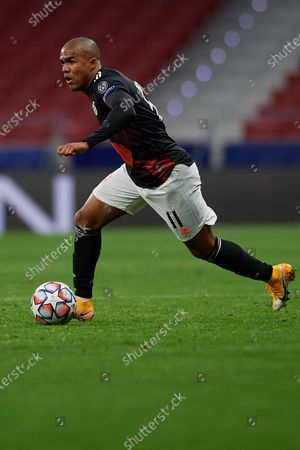 Douglas Costa of Bayern in action during the UEFA Champions League Group A stage match between Atletico Madrid and FC Bayern Muenchen at Estadio Wanda Metropolitano on December 1, 2020 in Madrid, Spain.