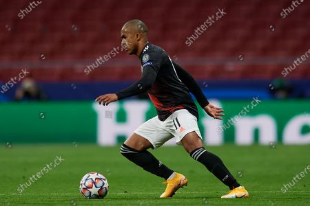 Douglas Costa of Bayern controls the ball during the UEFA Champions League Group A stage match between Atletico Madrid and FC Bayern Muenchen at Estadio Wanda Metropolitano on December 1, 2020 in Madrid, Spain.
