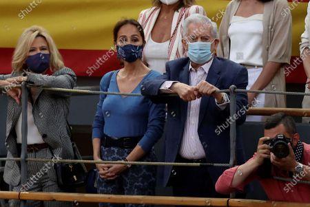 Peruvian writer Mario Vargas Llosa (C-R) and his partner, Spanish-Filipino socialite Isabel Preysler (C-L) attend the Saint Isidro Fair at Las Ventas bullring in Madrid, Spain, 21 May 2021.