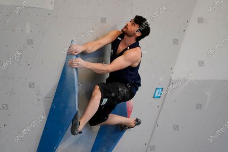 Britain's Nathan Phillips climbs during the men's boulder qualification at the climbing World Cu,p, in Salt Lake City