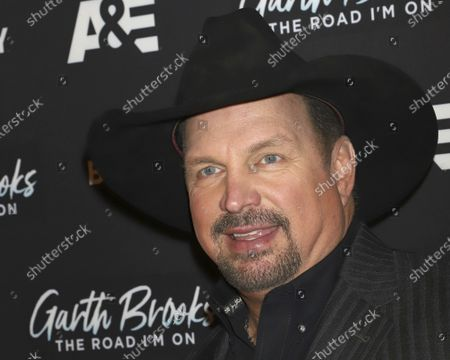 """Garth Brooks attends cocktails and conversation in celebration of A&E Biography's """"Garth Brooks: The Road I'm On"""" television special at The Bowery Hotel in New York. This year's Kennedy Center Honors will be a slimmed-down affair as the nation emerges from the coronavirus pandemic. The 43rd class of honorees includes country music legend Garth Brooks, dancer and choreographer Debbie Allen, actor Dick Van Dyke, singer-songwriter Joan Baez and violinist Midori"""