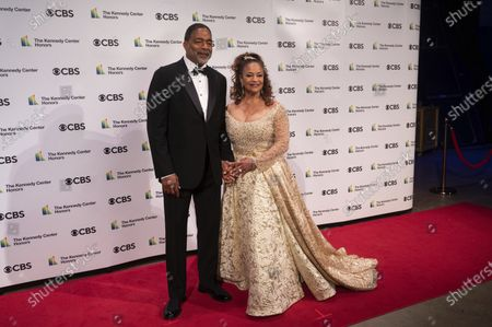 Kennedy Center honoree, choreographer, and actress Debbie Allen and Norman Nixon attend the 43nd Annual Kennedy Center Honors at The Kennedy Center, in Washington