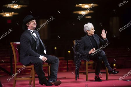 Stock Image of Singer-songwriter and activist Joan Baez, right, sings a song during a press event with country singer-songwriter Garth Brooks during the 43nd Annual Kennedy Center Honors at The Kennedy Center, in Washington