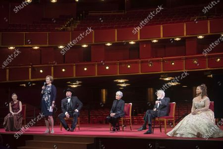 Kennedy Center President Deborah F. Rutter, second from left, speaks during a press event with the 2020 Kennedy Center honorees, from left, violinist Midori, country singer-songwriter Garth Brooks, singer-songwriter and activist Joan Baez, actor Dick Van Dyke, and choreographer, and actress Debbie Allen during the 43nd Annual Kennedy Center Honors at The Kennedy Center, in Washington