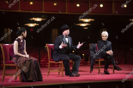 Country singer-songwriter Garth Brooks, center, speaks at a press event with violinist Midori, left, and singer-songwriter and activist Joan Baez during the 43nd Annual Kennedy Center Honors at The Kennedy Center, in Washington