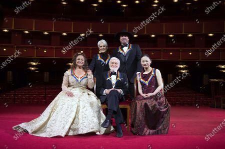 Stock Photo of Kennedy Center honorees, from left, choreographer, and actress Debbie Allen; singer-songwriter and activist Joan Baez; actor Dick Van Dyke; country singer-songwriter Garth Brooks; and violinist Midori pose for a group photos at the 43nd Annual Kennedy Center Honors at The Kennedy Center, in Washington