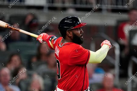 Atlanta Braves' Marcell Ozuna (20) follows through on a solo home run during the sixth inning of the team's baseball game against the Pittsburgh Pirates, in Atlanta
