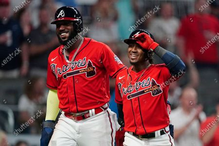 Stock Image of Atlanta Braves' Ozzie Albies, right, walks to the dugout with Marcell Ozuna after hitting a home run in the fifth inning of the team's baseball game against the Pittsburgh Pirates, in Atlanta