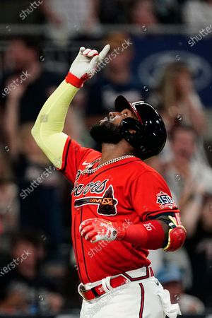 Atlanta Braves' Marcell Ozuna gestures after hitting a solo home run during the sixth inning of the team's baseball game against the Pittsburgh Pirates, in Atlanta