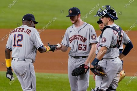Stock Picture of Houston Astros manager Dusty Baker Jr. (12) takes the ball from starting pitcher Tyler Ivey (63) as catcher Jason Castro and Yuli Gurriel wait during the fifth inning of a baseball game against the Texas Rangers in Arlington, Texas