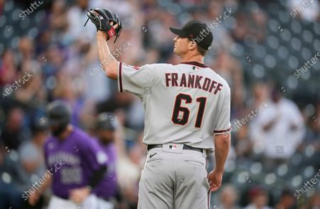 Arizona Diamondbacks starting pitcher Seth Frankoff waits for a new ball after giving up a two-run home run to Colorado Rockies' Ryan McMahon during the first inning of a baseball game, in Denver