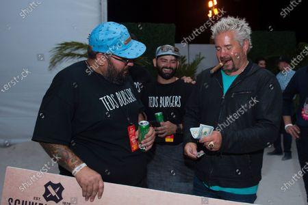 Winner of Burger Bash Chef Teodoro Armas of Ted's Burger, and Guy Fieri, attend the SOBEWFF® Burger Bash, in Miami Beach, Fla