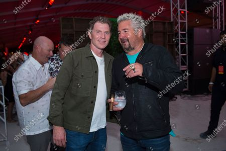 Chef Bobby Flay and Guy Fieri attend the SOBEWFF® Burger Bash, in Miami Beach, Fla