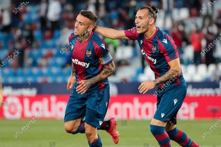 Levante's forward Roger Marti  (L) celebrate after scoring the 1-0 goal with his teammate  Francisco Javier Hidalgo, Son of Levante UD   during  spanish La Liga match between Levante UD  and  Cadiz  CF  at Ciutat de Valencia  Stadium on May 21, 2021 in Valencia, Spain.
